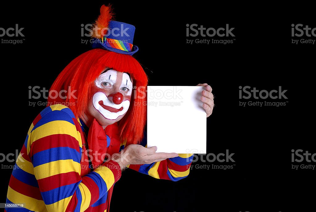 Circus Clown Holding a Blank Sign royalty-free stock photo