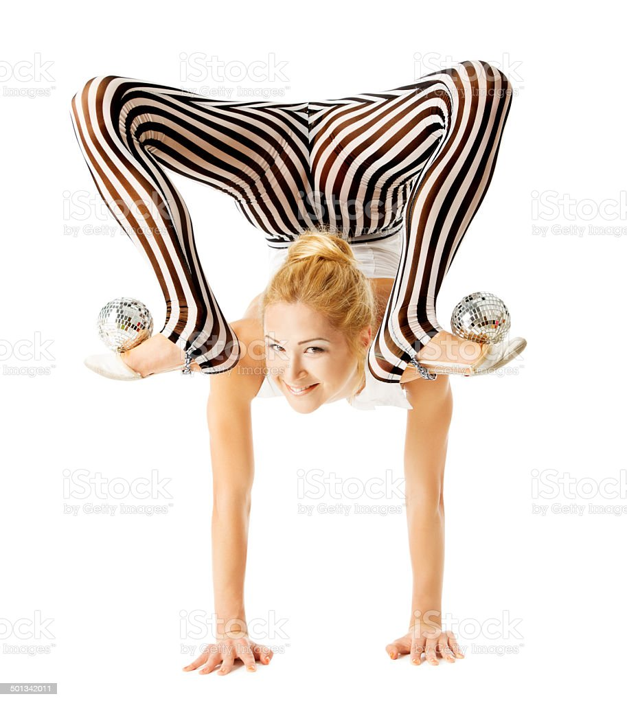 circus gymnast woman flexible body standing on arms upside down stock photo