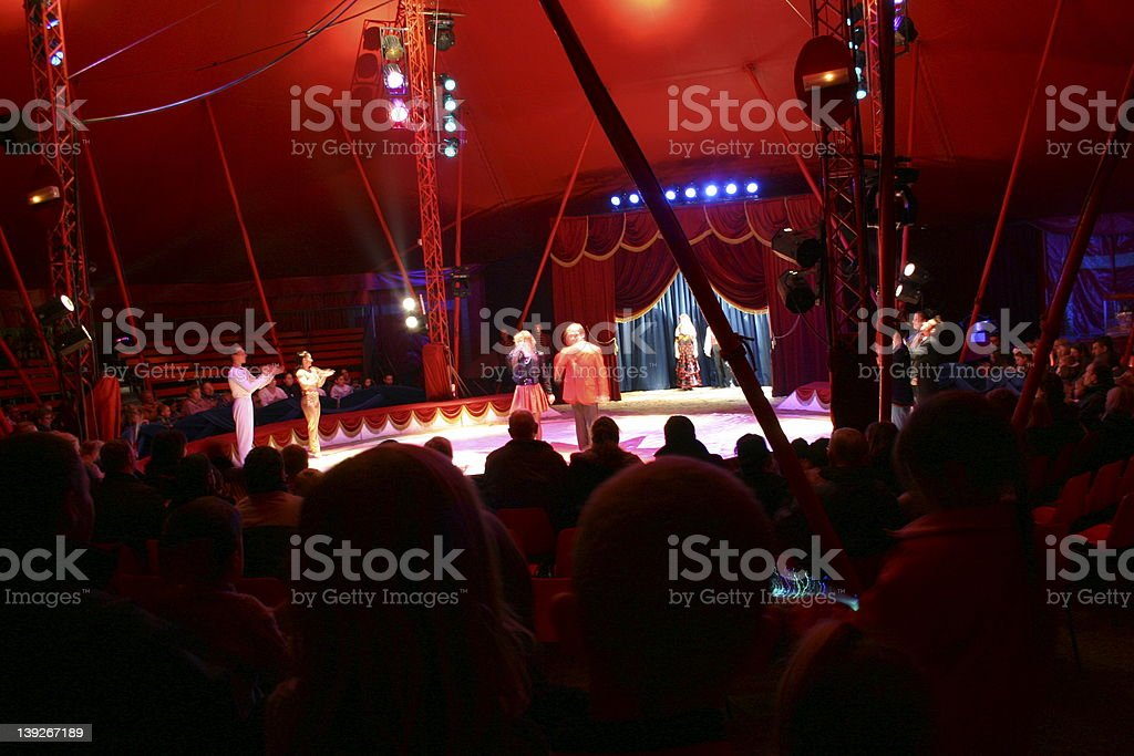 Circus performers and audience inside the big top stock photo