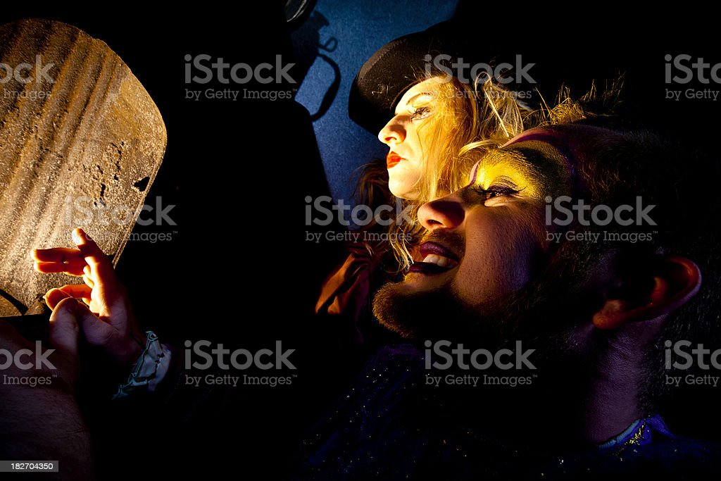 Circus Performers Feeling the Warmth from a fire royalty-free stock photo