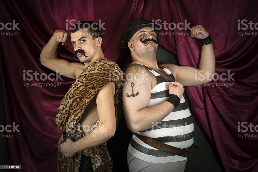 Circus strongman and animal tamer posing stock photo