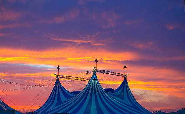circus tent in a dramatic sunset sky colorful - circus 個照片及圖片檔