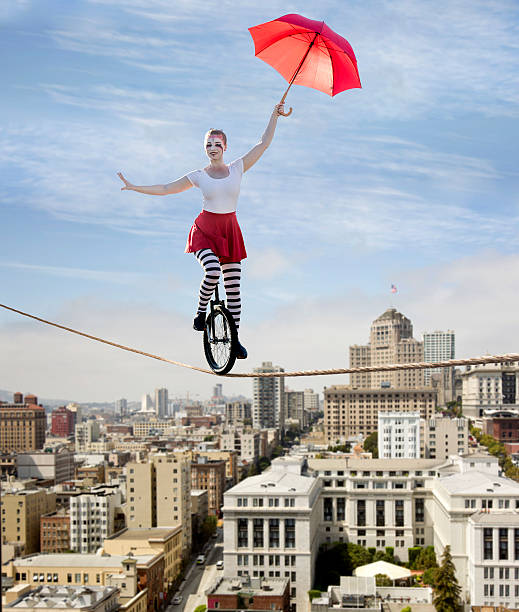 circus tightrope walker on a unicycle - circus 個照片及圖片檔