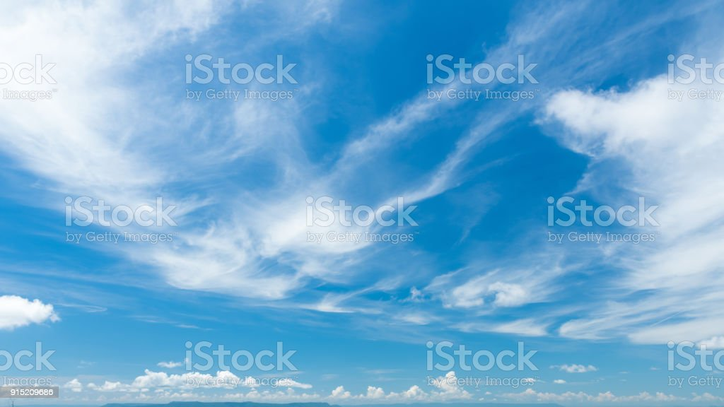 Cirrostratus cloudscape or Fluffy cirrus clouds on blue blue sky, Beautiful cirrocumulus on the high altitude layer stock photo