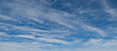 Cirrus clouds appear in a blue sky over Wupatki National Monument near Flagstaff, Arizona, USA.