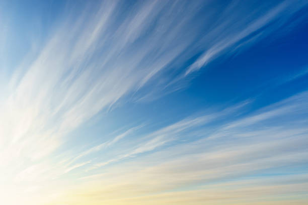 cirrus clouds on blue sky - wind stock photos and pictures