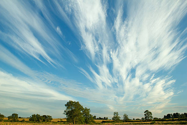cirrus clouds over farmland - dramatic sky stock photos and pictures