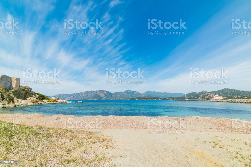 Cirrus clouds over Fortezza Vecchia beach royalty-free stock photo