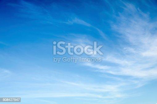Wispy, thin cirrus clouds against blue sky