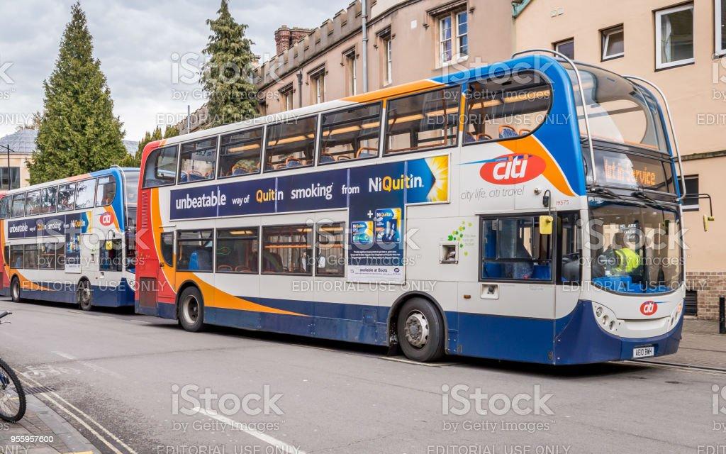 Citi double-decker buses queued up outside grand arcade bus stop, Cambridge, Cambridgeshire stock photo