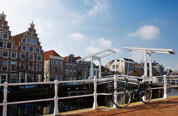 Cities; bike, bridge and canal stock photo
