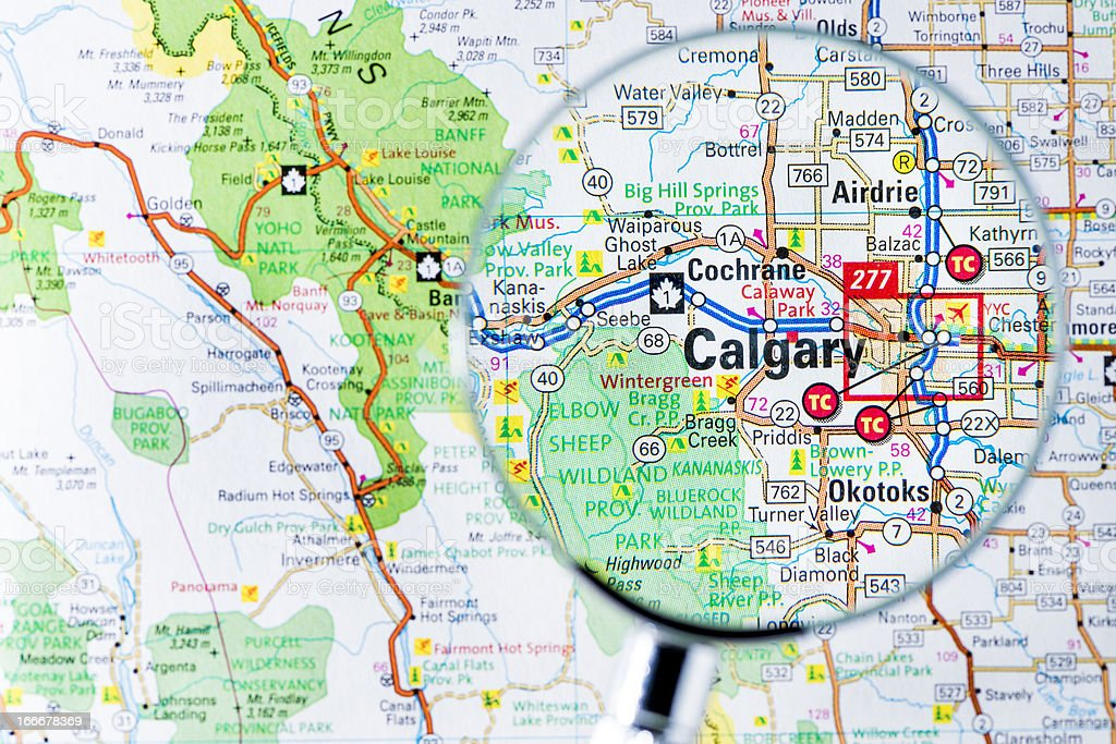 Cities under magnifying glass on map: Calgary stock photo
