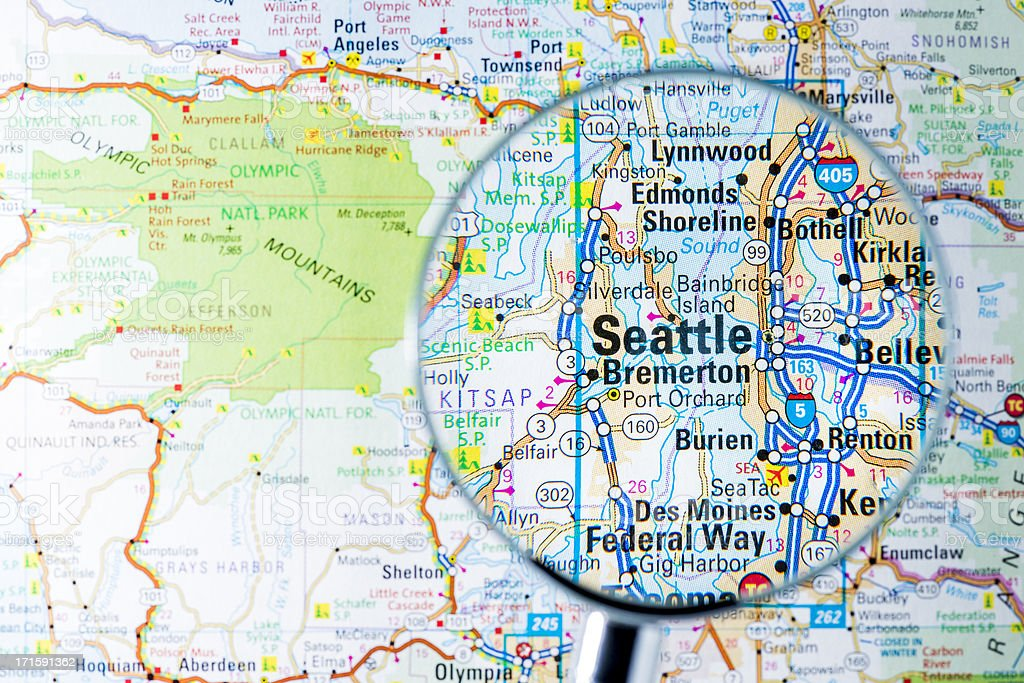 Cities under magnifying glass on map: Seattle stock photo
