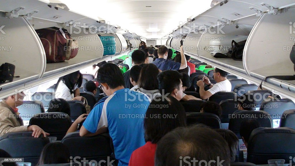 Citilink Airline Passengers Waiting For Disembarkation After Arrival At Bali.Airport.Indonesia stock photo
