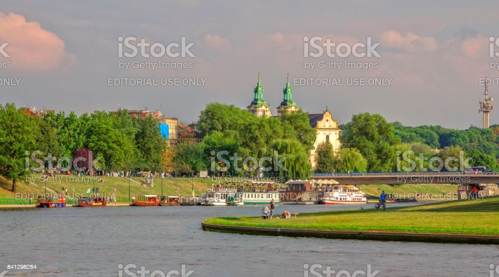 citizens and tourists walking and relaxing near Vistula river stock photo