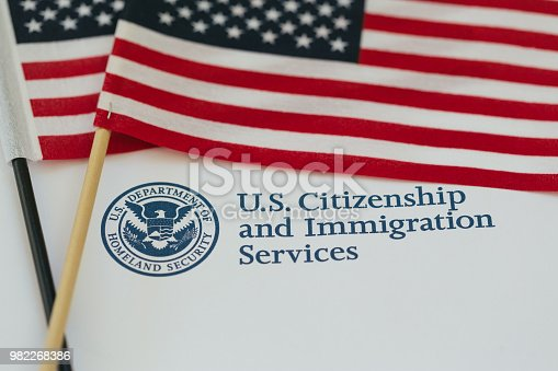 US flag and citizenship and immigration paperwork