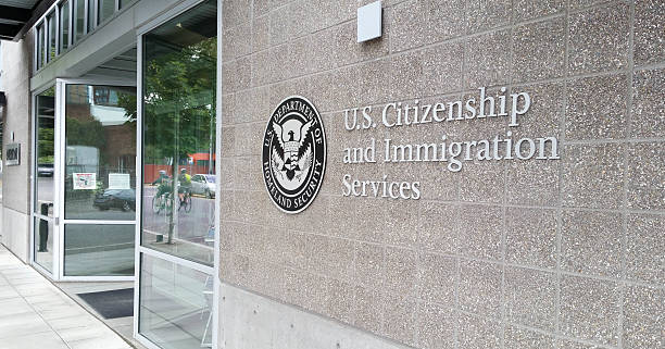 U.S. Citizenship and Immigration Services Office (USCIS) Portland, OR, USA - September 27, 2016: U.S. Citizenship and Immigration Services (USCIS) is a component of the United States Department of Homeland Security (DHS). It performs many administrative functions formerly carried out by the former United States Immigration and Naturalization Service (INS), which was part of the Department of Justice. immigrant stock pictures, royalty-free photos & images