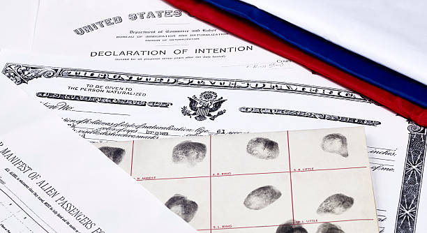 US Citizenship Documents Certificate of US Citizenship, declaration of intention, fingerprint card and passenger manifest with red, white and blue ribbon green card stock pictures, royalty-free photos & images