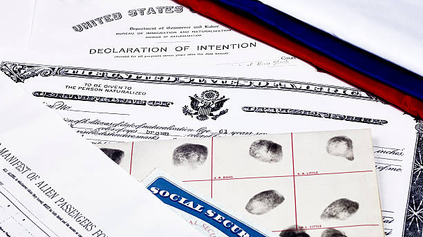 CItizenship Papers Certificate of US Citizenship, social security card, declaration of intention, and passenger manifest with red, white and blue ribbon citizenship stock pictures, royalty-free photos & images