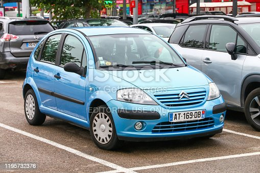 Occitanie, France - September 10, 2019: Cyan motor car Citroen C3 in the city street.