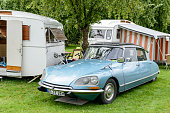 Citroen DS classic French limousine car camping with old caravans