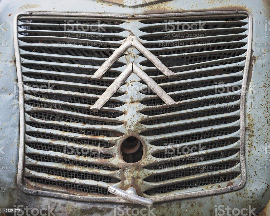 Citroen logo on rusted damaged grille of vintage 2CV car stock photo