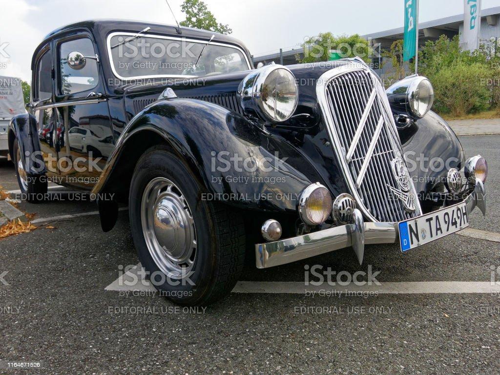 Black front view of a Citroen traction avant vintage 15/6 car: detail...