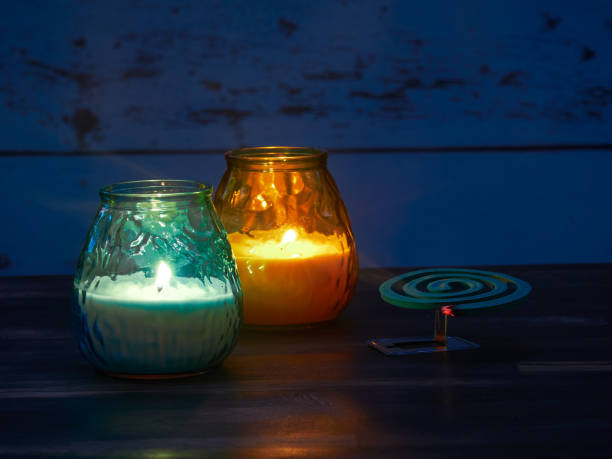 Citronella candles and mosquito spiral stock photo