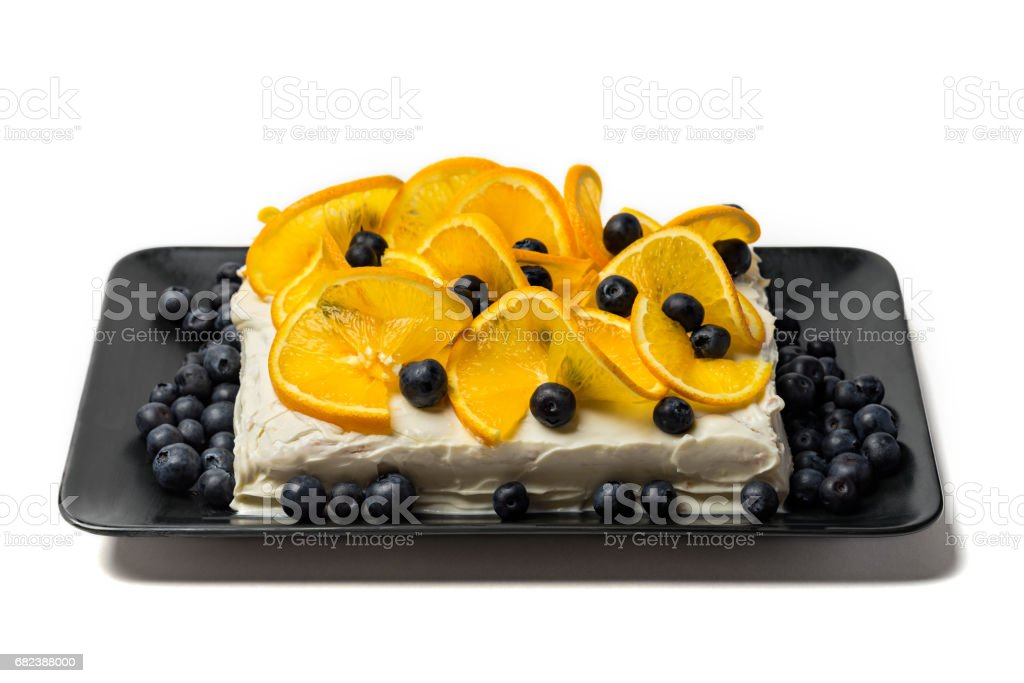 Citrus backed pie with berries on white background royalty-free stock photo