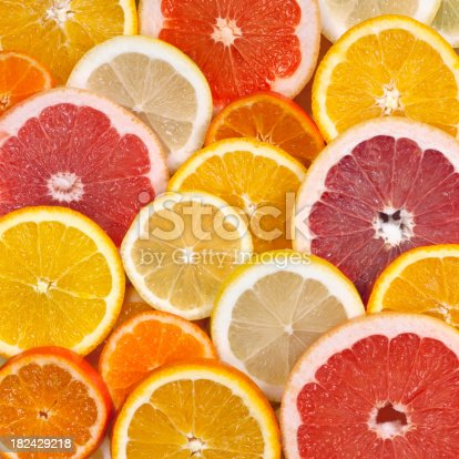 Closeup of sliced citrus fruits background