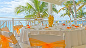 Table settings at a tropical destination wedding reception.
