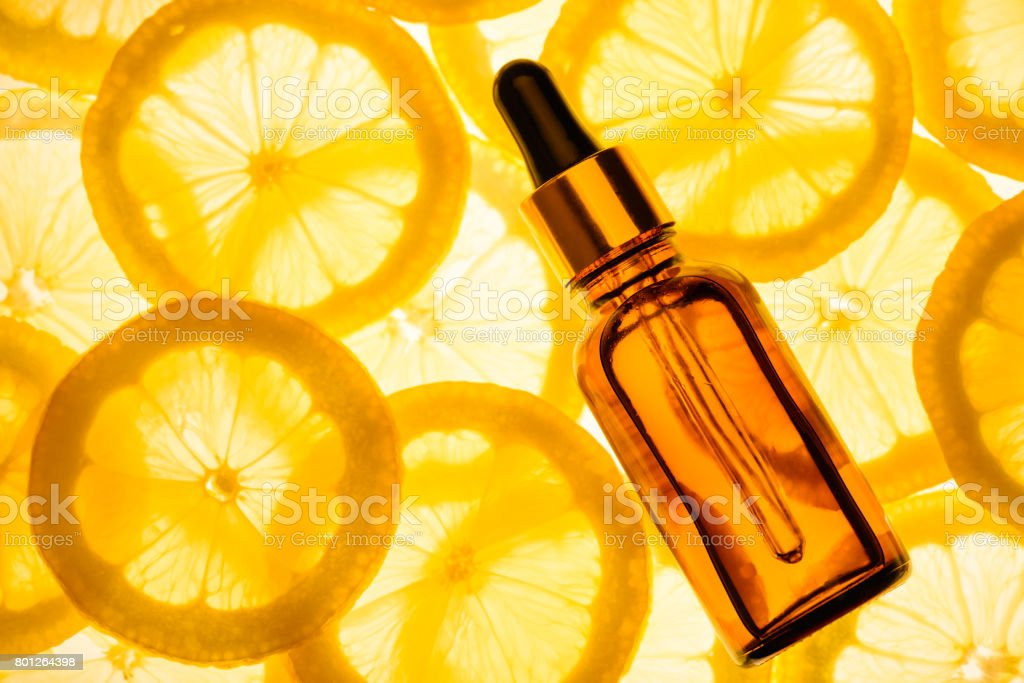 Citrus essential oil, vitamin c serum, beauty care aroma therapy. stock photo