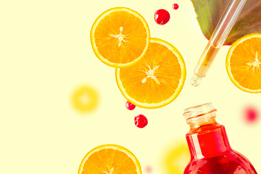 Citrus Essential Oil Vitamin C Serum Beauty Care Aroma Therapy Organic Spa Cosmetic With Herbal Ingredients Toning Stock Photo - Download Image Now