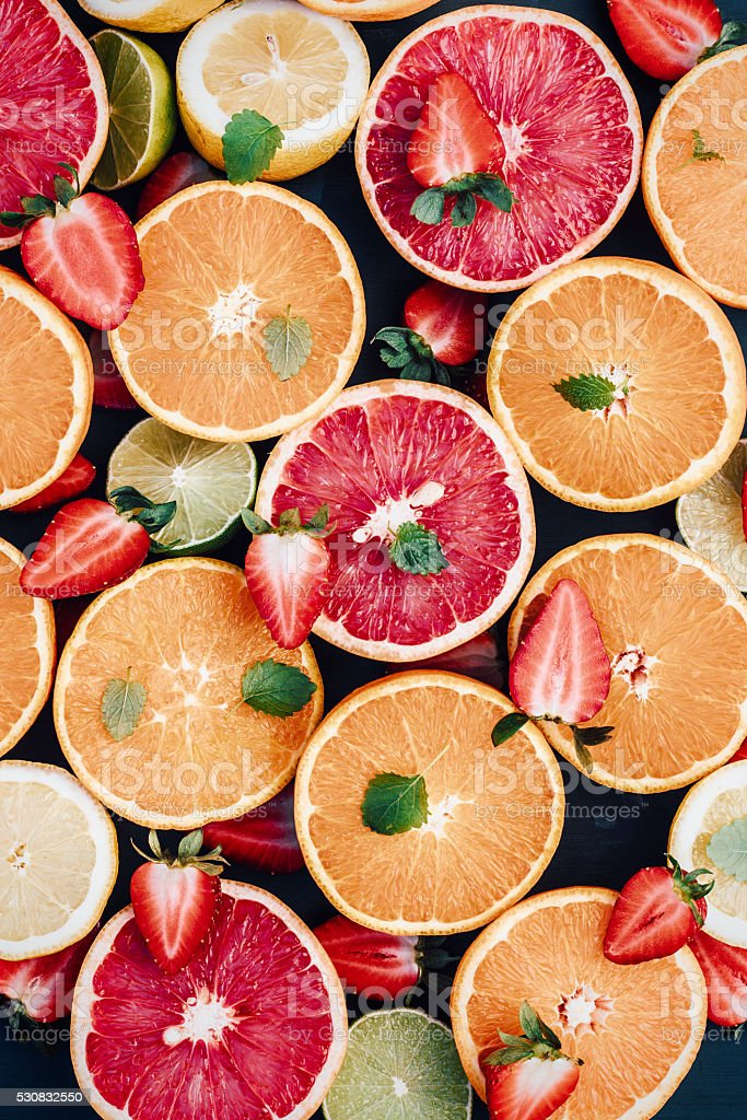 Citrus fruit arrangement from above stock photo