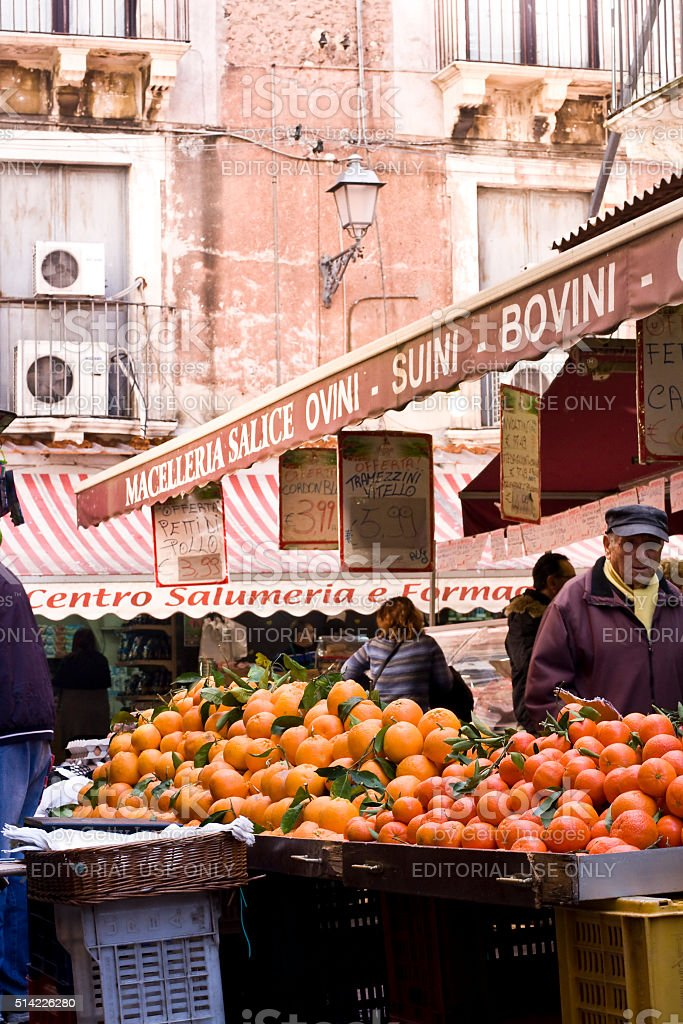 Citrus fruit stall at street market Catania, Sicily Island, Italy - February 02, 2016: stall with oranges and mandarins at street farmer market Awning Stock Photo