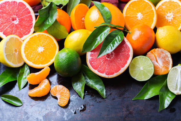 Citrus fruits background. Orange, grapefruit, tangerine, lime, lemon vitamin stock photo