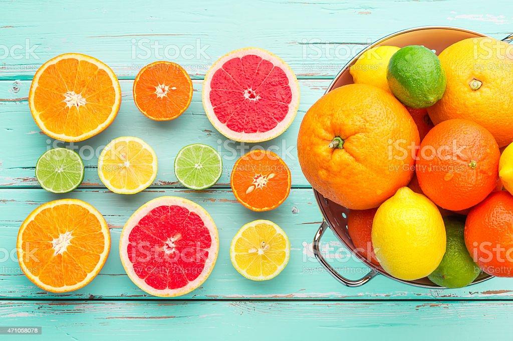 Citrus fruits in retro colander. stock photo