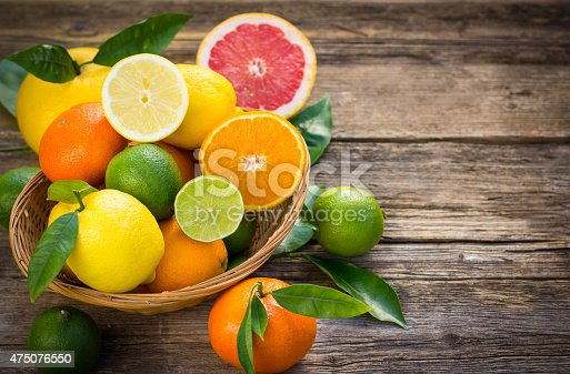 Citrus fruits in the basket on the rustic table