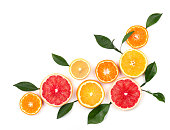 Pieces of lemon, pink grapefruit and orange isolated on white background, with clipping path. Top view