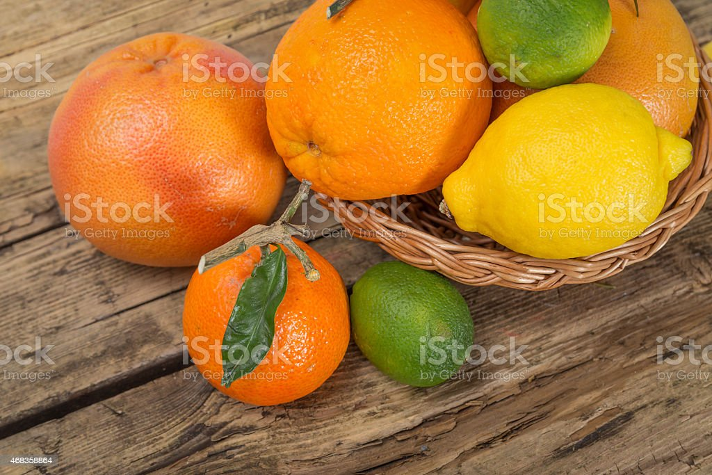 Citrus fruits on wooden background royalty-free stock photo