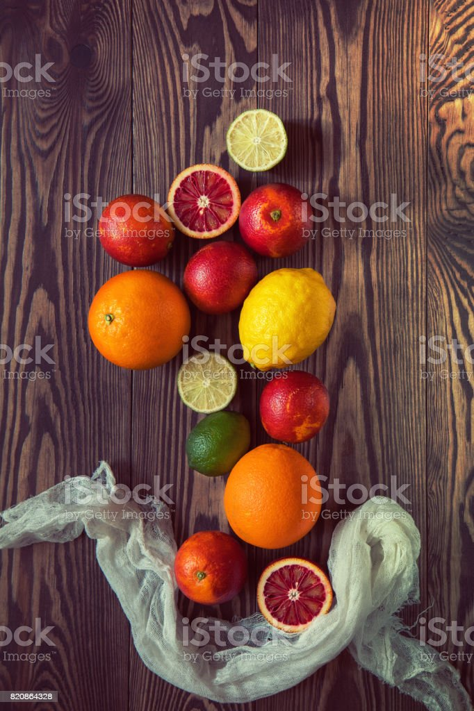 Citrus fruits over old dark wooden background. royalty-free stock photo