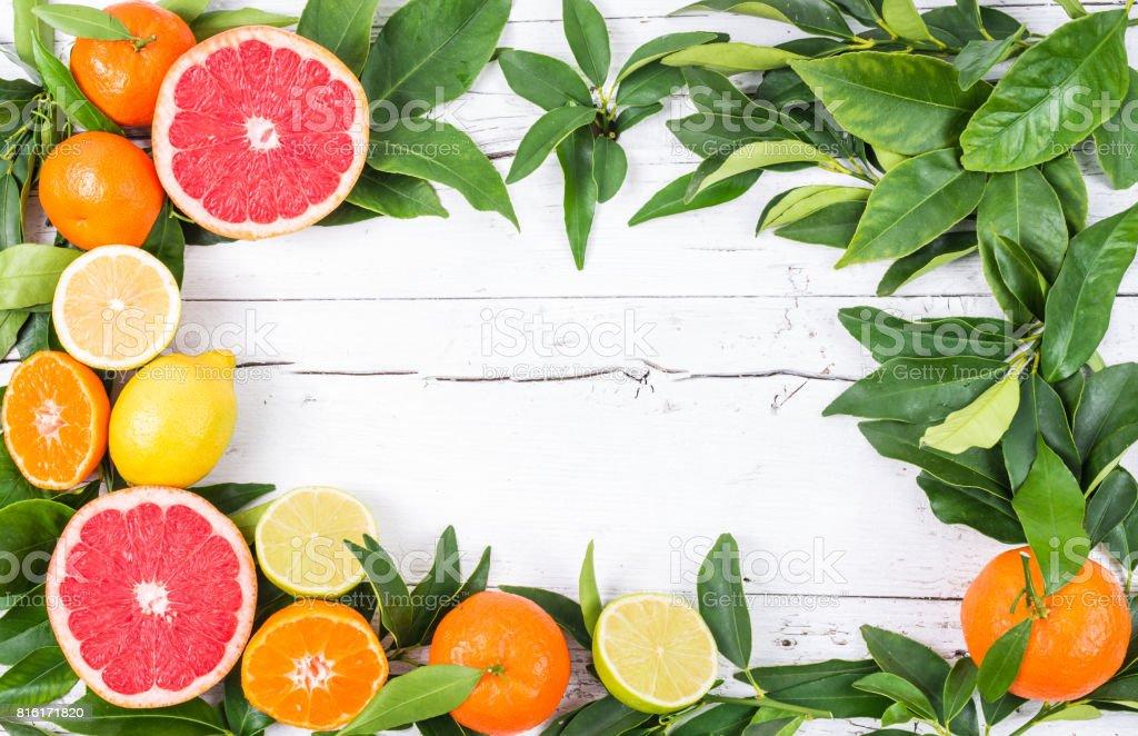 Citrus fruits vitamin C frame on white background. stock photo