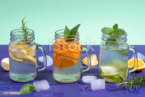Citrus infused water non alcohol cocktails with orange, lemon and lime fruits