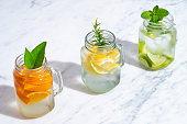 istock Citrus infused water non alcohol cocktails with orange, lemon and lime 1257065754