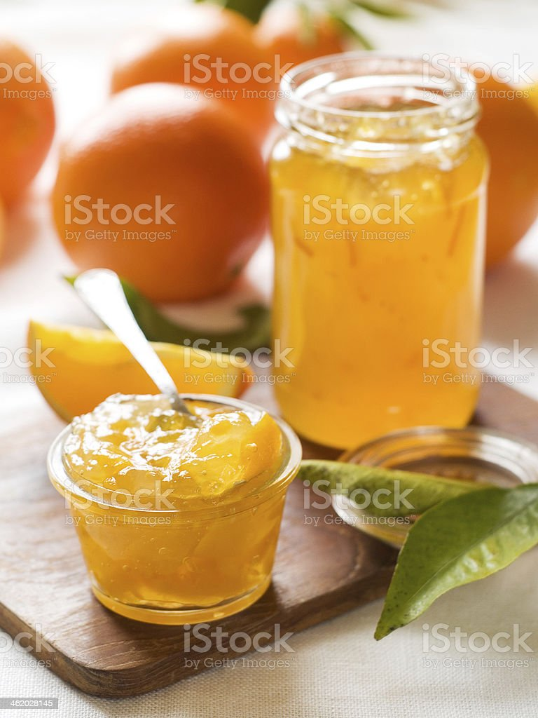 Citrus jam on wooden cutting board stock photo