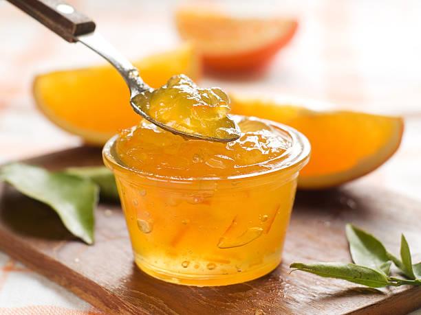Citrus jam Orange jam in glass jar, selective focus jello stock pictures, royalty-free photos & images