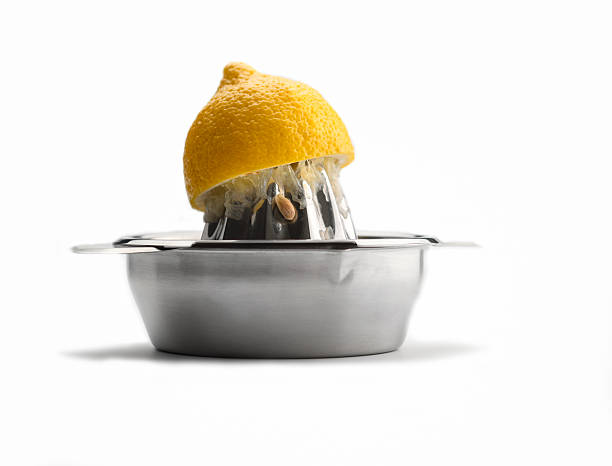 citrus juicer with one squeezed lemon on white - squeezing stock pictures, royalty-free photos & images
