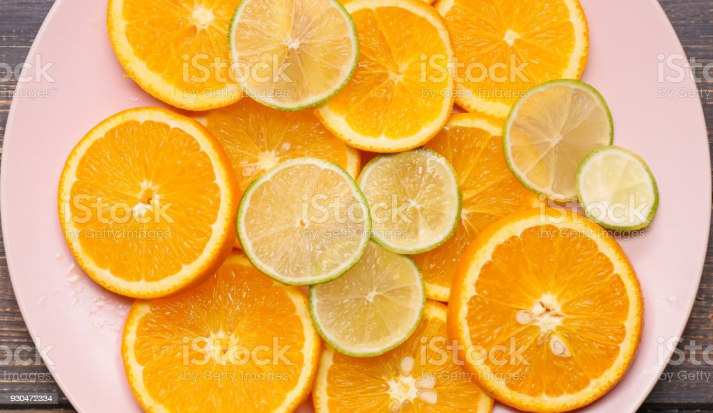 citrus slices on a wooden background stock photo