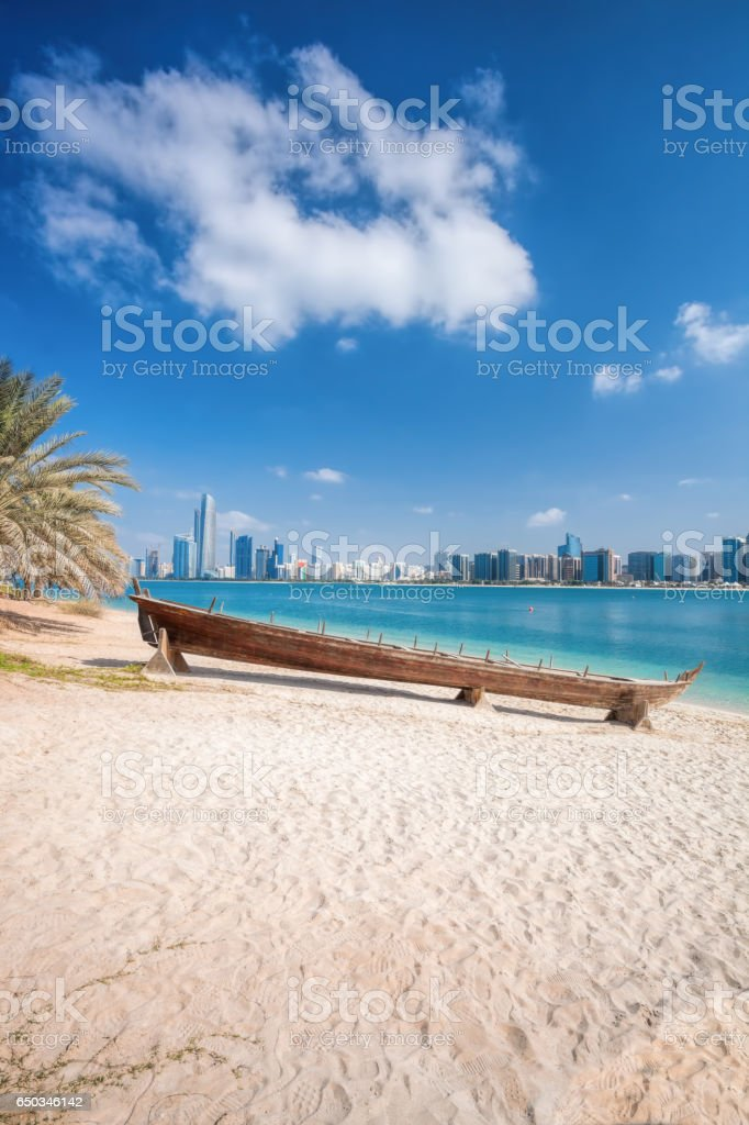 City Abu Dhabi with wooden boats in United Arab Emirates stock photo