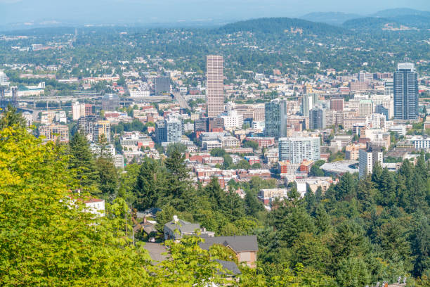 PORTLAND, OR - AUGUST 19, 2017: City aerial skyline from the hill. The city attracts 5 million people annually PORTLAND, OR - AUGUST 19, 2017: City aerial skyline from the hill. The city attracts 5 million people annually. annually stock pictures, royalty-free photos & images